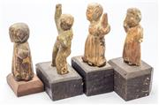 Sale 8269A - Lot 27 - A collection of four European polychrome timber figures, C17th, tallest 14cm  PROV: Lawsons, Justice Roderick Meagher QC Auction,...
