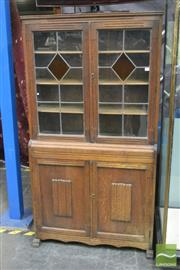 Sale 8359 - Lot 1048 - An Art Deco Oak Bookcase with 2 leadlight panel doors and 2 linen fold panel doors.
