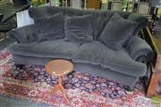 Sale 8532 - Lot 1190 - A Plush Grey Velvet Upholstered Three Seater Lounge, with curved form buttoned back H 95, W 230, D 125cm - Prov. Baz Lurhmann