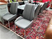 Sale 8777 - Lot 1039 - Nine Piece Glass Modern Dining Setting incl. Glass Top Table (H: 76 L: 220 W: 100cm) on Metal Base & Eight Modern Chairs