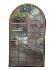 Sale 8912H - Lot 45 - A large arch form iron framed window fitted with mirrors, Height 180cm x 104cm