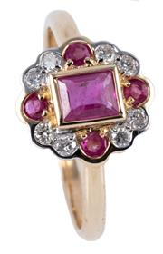 Sale 8974 - Lot 363 - A RUBY AND DIAMOND CLUSTER RING; centre bezel set in 9ct gold with a baguette cut treated ruby to scalloped surround of 8 round bril...