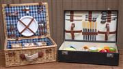 Sale 8984H - Lot 86 - Two picnic hampers, one of cane construction, the other of rigid suitcase form, both with near complete contents. W larger 64cm