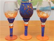 Sale 9044H - Lot 77 - Three Colin Heaney swirl glasses in blue and orange with speckle design, Height 24cm