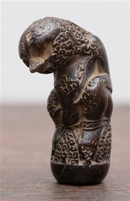 Sale 9160H - Lot 93 - A carved Indonesian mythical figural kris dagger handle with scrolling cirebon motif, Length 7.5cm