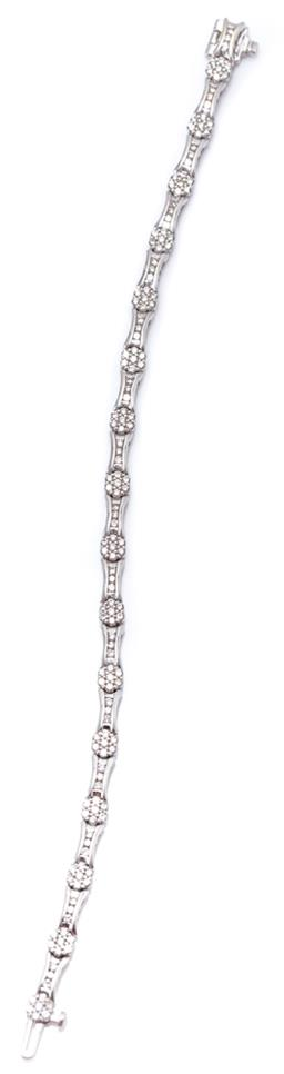 Sale 9168J - Lot 383 - AN 18CT WHITE GOLD DIAMOND BRACELET; composed of 16 cluster links each set with 7 round brilliant cut diamonds to 16 uniting links e...