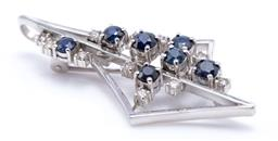 Sale 9194 - Lot 395 - A WHITE GOLD SAPPHIRE AND DIAMOND PENDANT BROOCH; geometric drop set with 6 round round cut blue sapphires and 11 round brilliant cu...