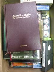 Sale 8125 - Lot 57 - Box of mostly rugby books, a Tony Locket 1300 video and three golfballs!