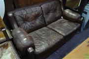 Sale 8566 - Lot 1608 - Moran Leather Chequered Pattern Button Backed Two Seater Sofa