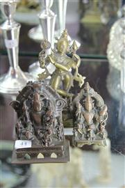 Sale 8195 - Lot 44 - Indian Bronze Figure of a Deity with a Pair of Smaller Examples