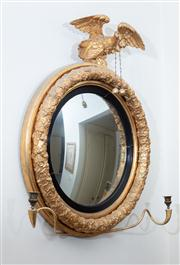 Sale 8815A - Lot 17 - A regency style convex mirror with eagle surmount and fruiting vine circular frame with scrolled sconce application, H 85cm, W 73cm