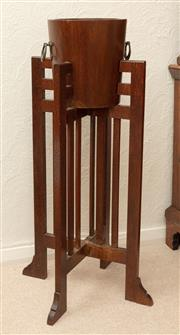 Sale 9066H - Lot 15 - An art deco oak jardiniere with iron ring handles, the removable bucket on a squared stand. H 95cm W 42cm.