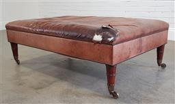 Sale 9179 - Lot 1024 - Oversized 19th Century Style Brown Leather Ottoman, with studs & on turned legs with castors - tear to one corner of upholstery (h:4...