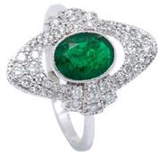 Sale 8991 - Lot 389 - AN 18CT WHITE GOLD DECO STYLE EMERALD AND DIAMOND RING; centring an oval cut emerald of approx. 1.05ct to elongated surround and geo...