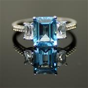 Sale 8196F - Lot 391 - A 10CT WHITE GOLD GEMSET RING; set with blue topaz, white stones and diamonds, size N 1/2.
