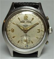 Sale 8362A - Lot 13 - A vintage mens Heuer triple date wristwatch; restored dial, in good condition and golden hands, centre second, fine Swiss automatic...