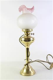 Sale 8944T - Lot 680 - Gilt metal keroscene lamp with frilled pink glass shade (H63cm)