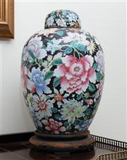 Sale 8815A - Lot 7 - A Chinese ovoid covered jar profusely decorated with peonies and other gay flowers on a timber stand, H 45cm