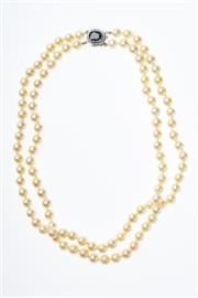 Sale 8293 - Lot 380 - A TWO ROW AKOYAL PEARL NECKLACE: composed of 102 cultured pearls, 7 - 7.5mm round of cream colour and good lustre to a 14ct white go...