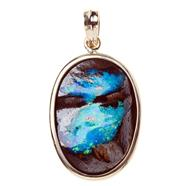 Sale 8400 - Lot 322 - A 9CT GOLD OPAL PENDANT; oval polished Boulder opal  33.9 x 23.5mm with mostly blue and green colour.