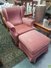 Sale 8593 - Lot 1081 - Pink Upholstered Armchair with matching Footstool