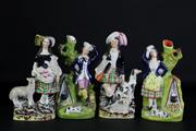 Sale 8931B - Lot 629 - Staffordshire Set Of Four Figures With Animals Tallest 26cm (one dog head broken off)