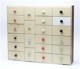 Sale 9123J - Lot 347 - An interesting depression era set of 22 drawers with multi-coloured handles, height 57, width 66, depth15cm