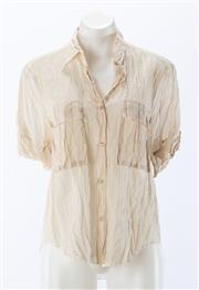 Sale 8910F - Lot 22 - An ACME semi sheer cotton organza top with twin pockets to front, size 36, as new with tags