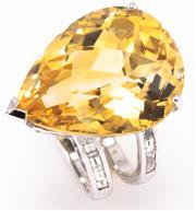 Sale 8937 - Lot 458 - AN 18CT WHITE GOLD DIAMOND AND GEMSTONE RING; centring an approx. 27.50ct pear cut chequerboard citrine on a double shank shoulders...