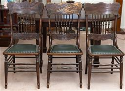 Sale 9103M - Lot 740 - A set of three country style spindle back chairs with pressed features and green leather seats, Height of back 97cm