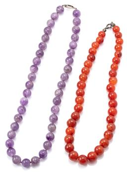Sale 9145 - Lot 315 - TWO GEM BEAD NECKLACES; 12mm round amethyst beads to metal clasp, length 53cm, and an a strand 11-14mm round graduated agate beads t...