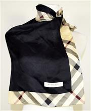 Sale 8460F - Lot 5 - A Burberry 100% silk square form scarf in black with classic check border, 58 x 58cm