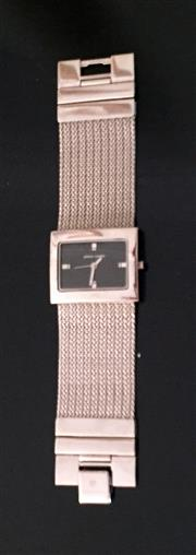 Sale 8562A - Lot 179 - A Pierre Cardin stainless steel rectangular dress watch with mesh band, small