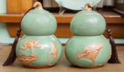 Sale 8795A - Lot 40 - A pair of gourd shaped Oriental celadon lidded containers, each with tassels, each height: 17 cm