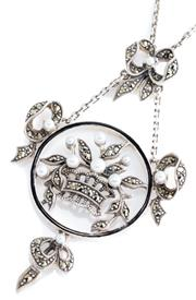 Sale 8965 - Lot 395 - AN EDWARDIAN STYLE SILVER STONE SET PENDANT NECKLACE; designed as a basket of flowers within a ring of black enamel to articulated b...