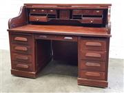 Sale 9085 - Lot 1020 - Late 19th/ Early 20th Century Walnut Roll-Top Desk, with fitted interior, above a knee-hole drawer & two pedestals with slide (missi...
