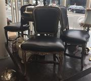 Sale 8310A - Lot 12 - A set of four continental style dining chairs with black leather upholstery and carved timber frames and stretcher base.