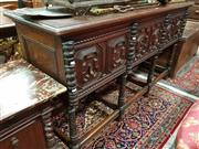 Sale 8774 - Lot 1068 - Early 20th Century Oak Dresser Base, in the 17th century style, with three deep panelled drawers, flanked by carved supports & legs...