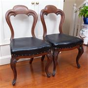 Sale 8815A - Lot 55 - A pair of mid C19th mahogany dining chairs with black leather upholstery to padded seat