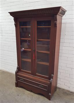 Sale 9142 - Lot 1015 - Early 20th Century Blackwood Legal Bookcase, with two glass panel doors enclosing shelves, above a breakfront base with drawer - k...
