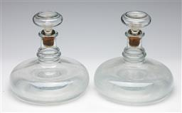 Sale 9253 - Lot 228 - A pair of squat glass decanters with cork based stoppers (H:18.5cm)