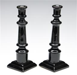 Sale 9253 - Lot 224 - A pair of glazed black ceramic candle holders (H:30.5cm) - minor chips to glaze