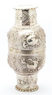 Sale 8269A - Lot 46 - Two interlocking continental silver travelling cups, with repousse flower heads and scrolls, inscribed Kildevand og Kaerlighed Soll...