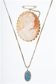 Sale 8293 - Lot 307 - CAMEO BROOCH AND STONE SET PENDANT NECKLACE; carved shell cameo in a gilt frame, and an opal doublet set in 9ct on a 9ct box chain (...