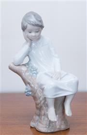 Sale 8369A - Lot 10 - A Lladro figure of a boy in a nightgown on a tree stump, H 21cm