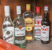 Sale 8489A - Lot 61 - 4 x bottles of clear spirits including rum & gin, together with a bottle of Pimms