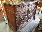 Sale 8774 - Lot 1098 - Late 19th Century French Renaissance Style Carved Walnut Cabinet, with black marble top (broken), long drawer, two figural panel doo...
