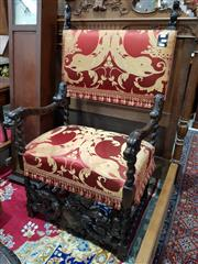Sale 8774 - Lot 1046 - 17th Century Style Carved Armchair, with stylised fish terminals and upholstered in red and yellow damask, with barley twist support...