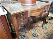 Sale 8814 - Lot 1093 - Late Victorian Rosewood & Marquetry Ladys Desk, with bowed centre and leather top, fitted with seven drawers & on tapering legs (Ke...