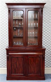 Sale 8815A - Lot 31 - A mahogany display cabinet, the glazed doors to superstructure revealing shelved interior, the base with single drawer and two panel...